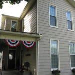 Tan Vinyl Siding 2 Story Home FOR SALE