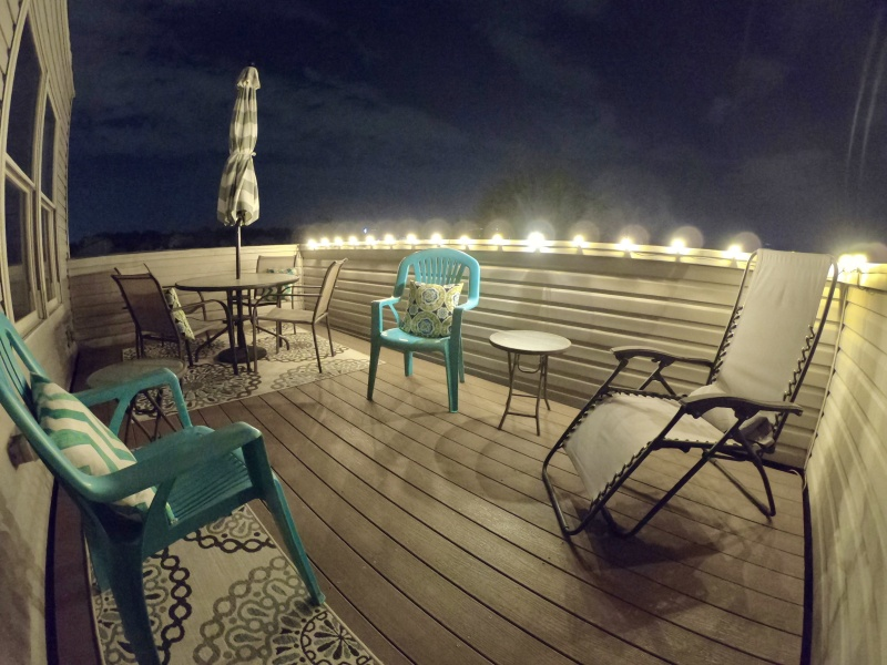 Talk about cozy and inviting! This rooftop deck at Night is even MORE AMAZING!